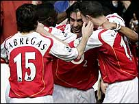Liverpool's Milan Baros and Arsenal's Philippe Senderos