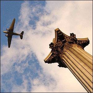 A Dakota plane flies over Trafalgar Square