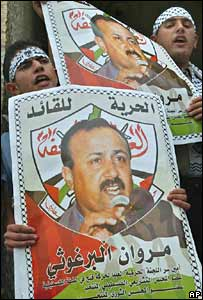 Students hold posters of Marwan Barghouti in the West Bank town of Nablus