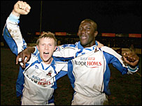 Nuneaton's Robert Oddy and Terry Angus celebrate putting the club through to the third round