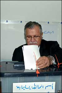 Iraqi President Jalal Talabani casts his ballot in the northern city of Sulaimaniyah