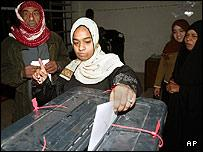 An Iraqi woman casts her ballot at an election centre in Baghdad