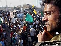Iraqi soldier watches over protest by Shias