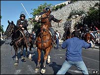 Israeli mounted police charge to disperse Palestinian protesters