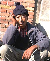 Suman Tamang, whose 20-year-old daughter was killed, grieves outside hospital in Bhaktapur