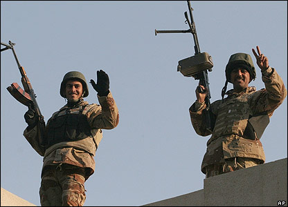 Soldiers on the roof of an election centre in Baghdad