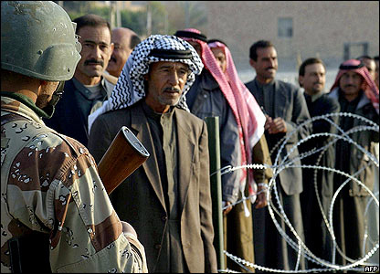 Voters queue in Kusaiybah, in Anbar province. [Image released by the US marines]