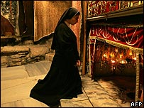 A nun prays in Church of the Nativity in Bethlehem