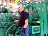 Tony Mockett stands next to a power generator set at Cummins plant, Ramsgate