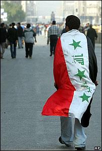 Man draped in Iraq flag