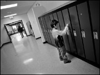 A boy tends to his locker in school in Natuashish (photograph: Dominick Tyler)