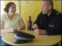 Pc Keith Sinclair with Irina Almeida in the Portuguese deli in Wrexham 