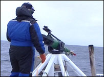 Whaler prepares to fire harpoon (BBC)