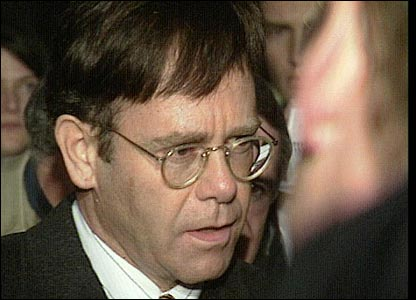 Sir Elton leaving the High Court after winning damages from the Sunday Mirror newspaper in 1993 over a report on his health