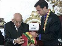 President Hugo Banzer handing over the ceremonial sash to his successor, Jorge Quiroga