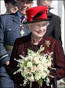 The Queen holding a bouquet of flowers