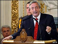 President Nestor Kirchner announces the early debt repayment