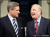 Canadian election rivals Stephen Harper (L) and Paul Martin speak before debate
