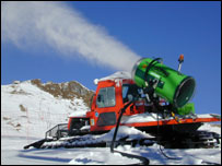 A snowmaker pumps snow on to the slopes