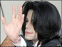 Michael Jackson waves as he arrives at the court in Santa Maria, California