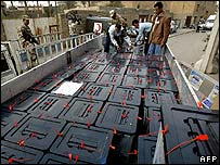 Ballot boxes loaded onto a van