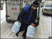 A man carries water supplies in Khabarovsk, near the Russian-Chinese border