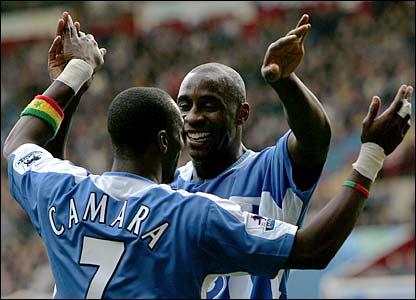 Wigan's Henri Camara and Jason Roberts