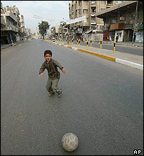 Boy playing football in Baghdad