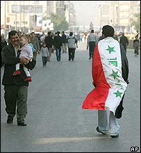 Man draped in Iraqi flag