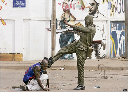 Togolese soldier kicking protester in the head