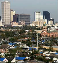 View of the New Orleans skyline with blue tarpaulins covering damaged roofs