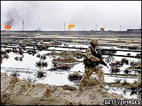 Soldier patrols burning Iraqi oil field