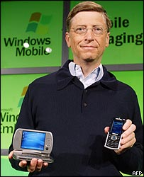 Bill Gates with the Universal by HTC and the Samsung i300 at the Windows Mobile launch