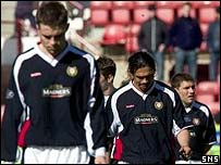 Dundee's players troop off East End Park after defeat