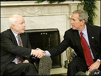 John McCain and George W Bush shake hands at the White House