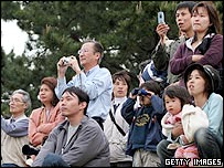 People gather to see a grey whale swimming in Tokyo Bay on May 8, 2005 in Sodegaura, Chiba Prefecture, Japan.