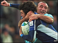 Leinster's Shane Horgan is tackled by Bourgoin hooker Benoit Cabello