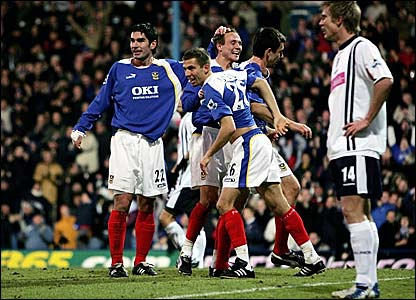 Svetoslav Todorov is congratulated after scoring Portsmouth's winner at Fratton Park
