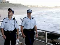 Australian police patrol a beach in Sydney