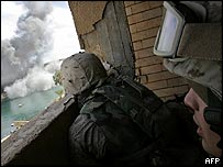 US Marines tackle insurgents in Haklanyah, 23 February 2005, west of Baghdad.