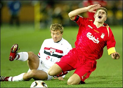 Lugano receives a booking for his challenge Gerrard
