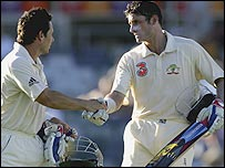 Brad Hodge and Mike Hussey congratulate each other at the end of day three