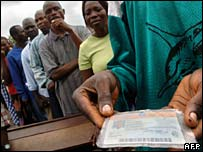 Voters queue outside a polling station in Kinshasa, DR Congo