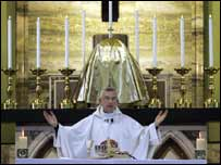 Priest at memorial service