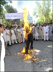 Afghan university students burn an effigy of US President George W Bush during a protest in Jalalabad, Afghanistan