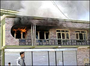 An office building burns after a protest by university students in Jalalabad, Afghanistan
