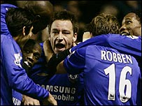 Joe Cole (left) and Arjen Robben (right) celebrate Chelsea's win with captain John Terry