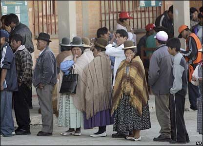 Bolivians queue at a polling station