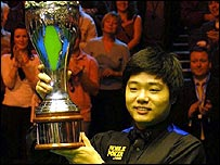 Ding Junhui lifts the UK Championship trophy