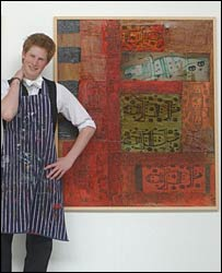 Prince Harry poses with some of his artwork